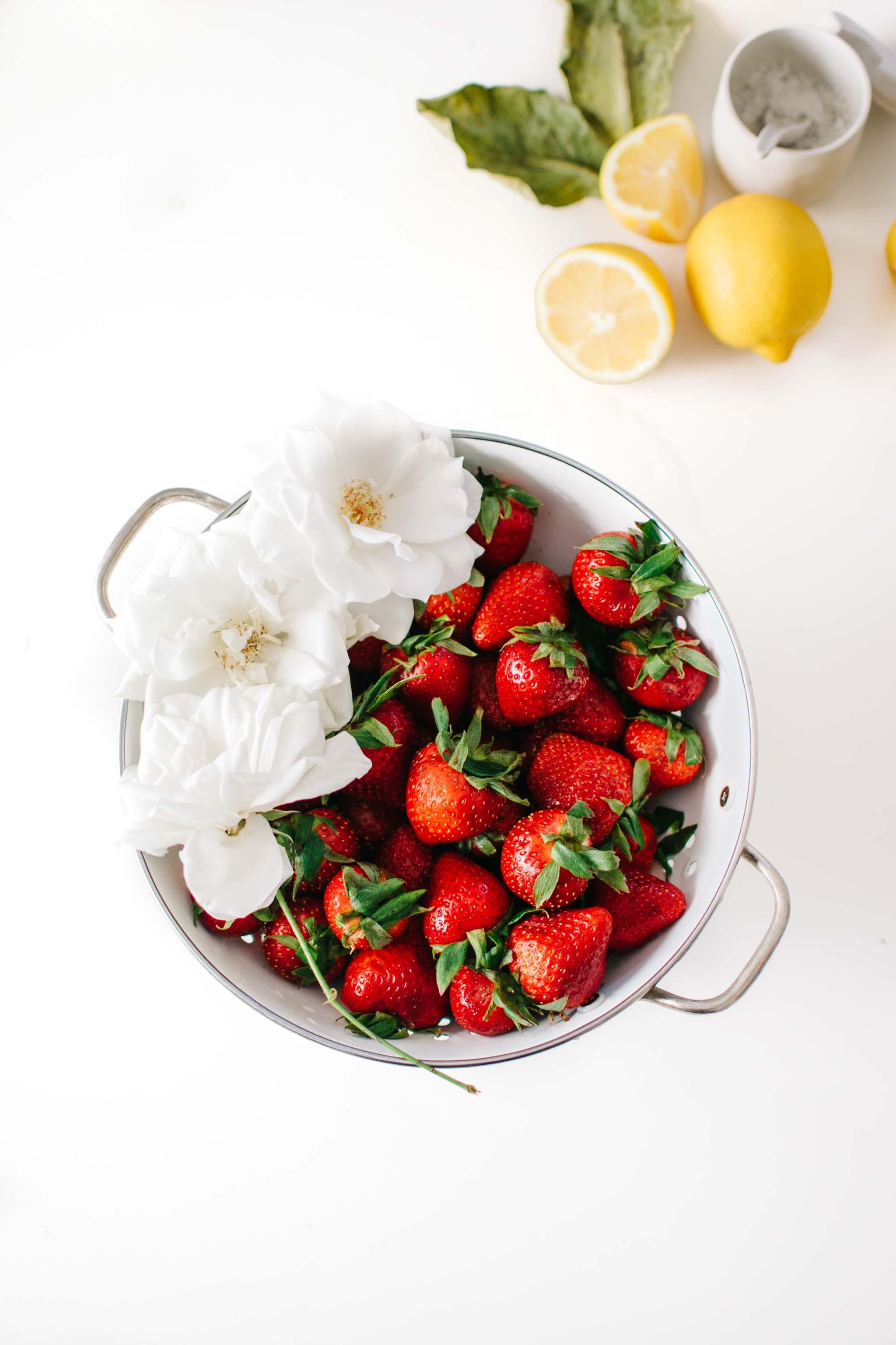 colander roses strawberries lemons