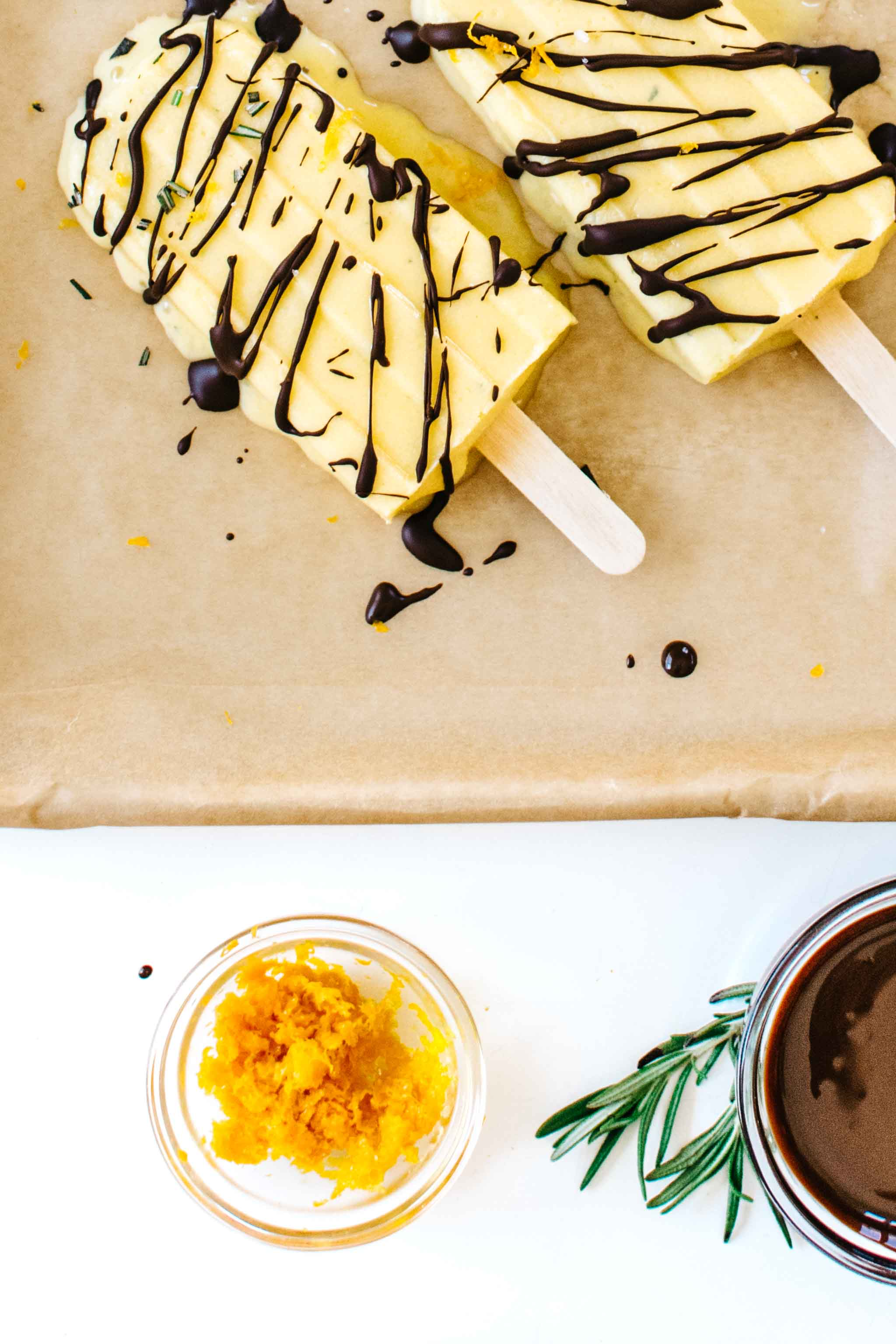 Sweet Orange & Rosemary Creamsicles with Salty Chocolate Drizzle from Kale & Caramel: Recipes for Body, Heart, and Table