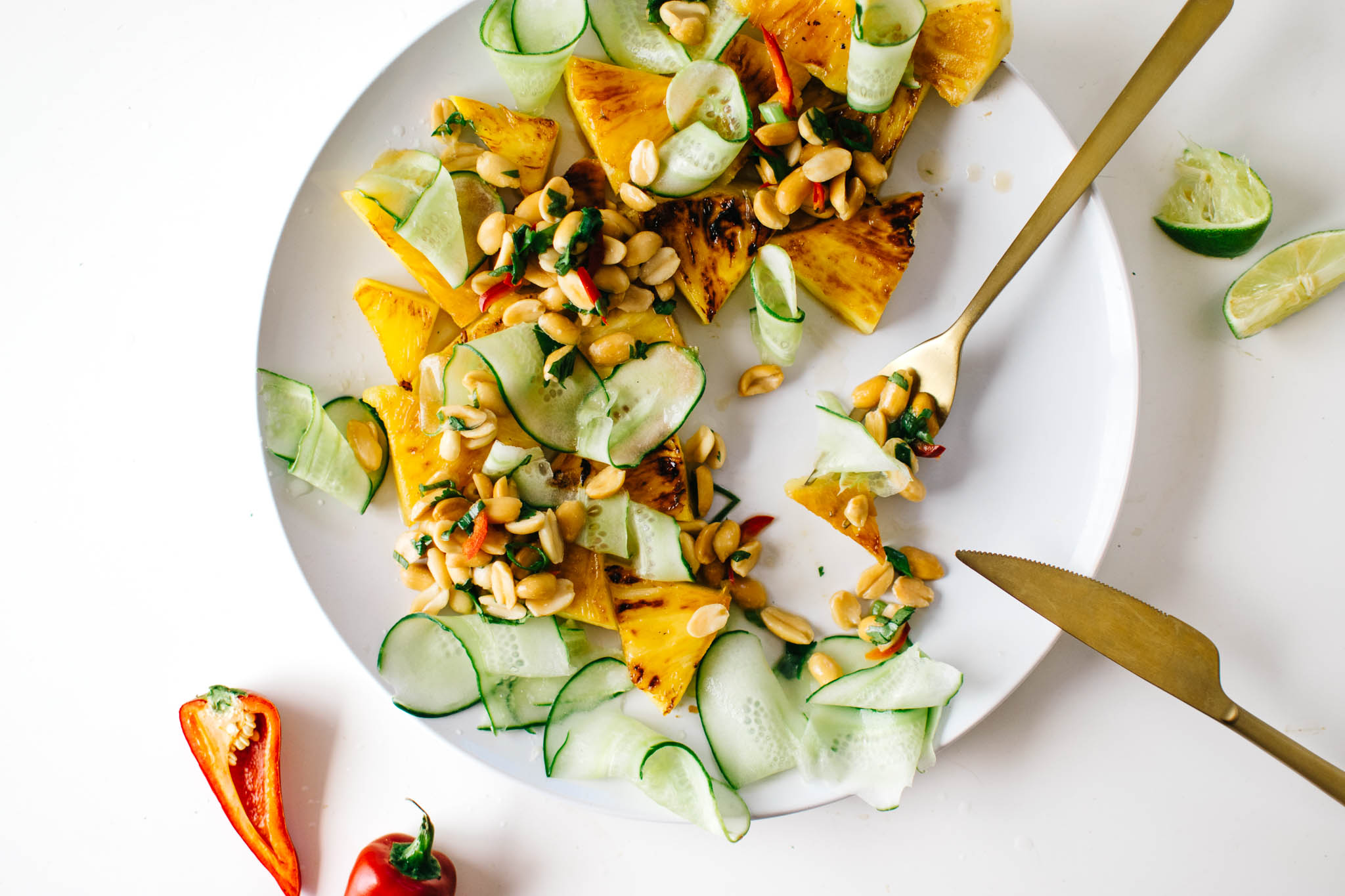 GRILLED PINEAPPLE & CUCUMBER SALAD WITH SPICY PEANUTS.