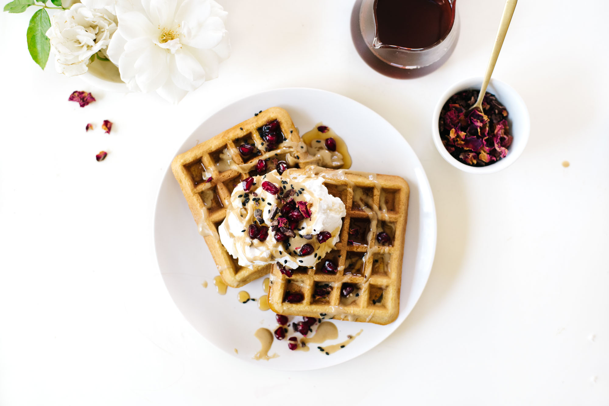 COCONUT TAHINI WAFFLES WITH CARDAMOM ROSE COCONUT CREAM.